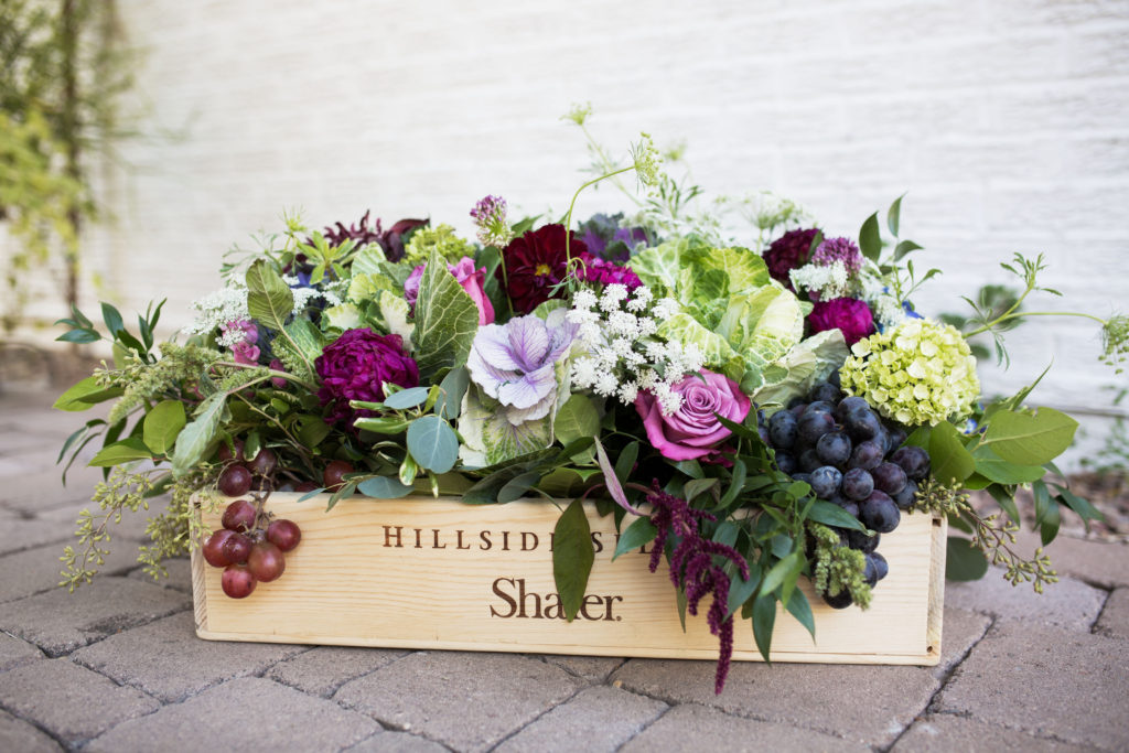 wine-themed floral arrangement