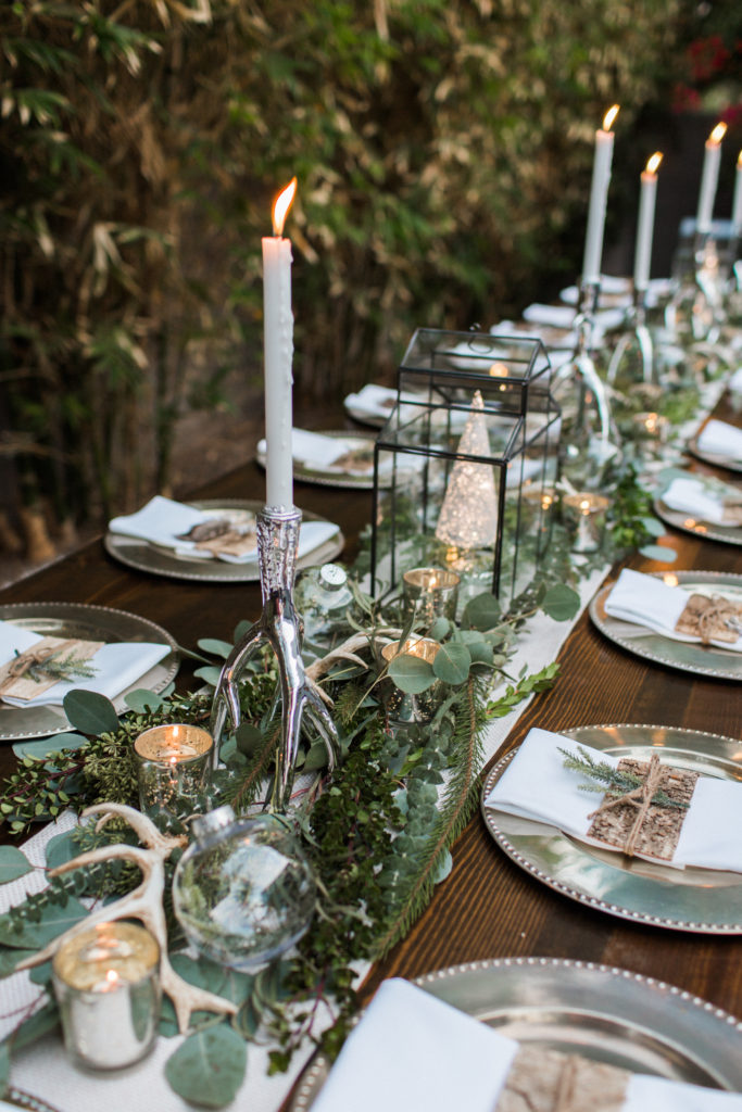 Layered greenery as centerpiece