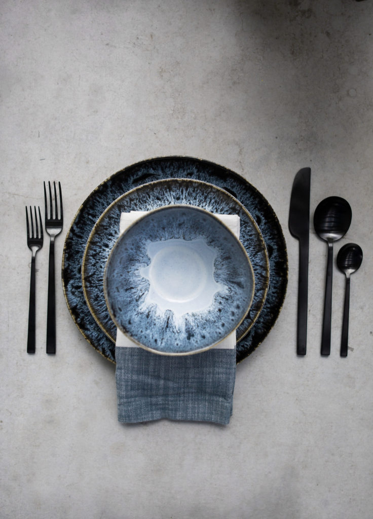 reactive glazed dinnerware and stainless steel black flatware
