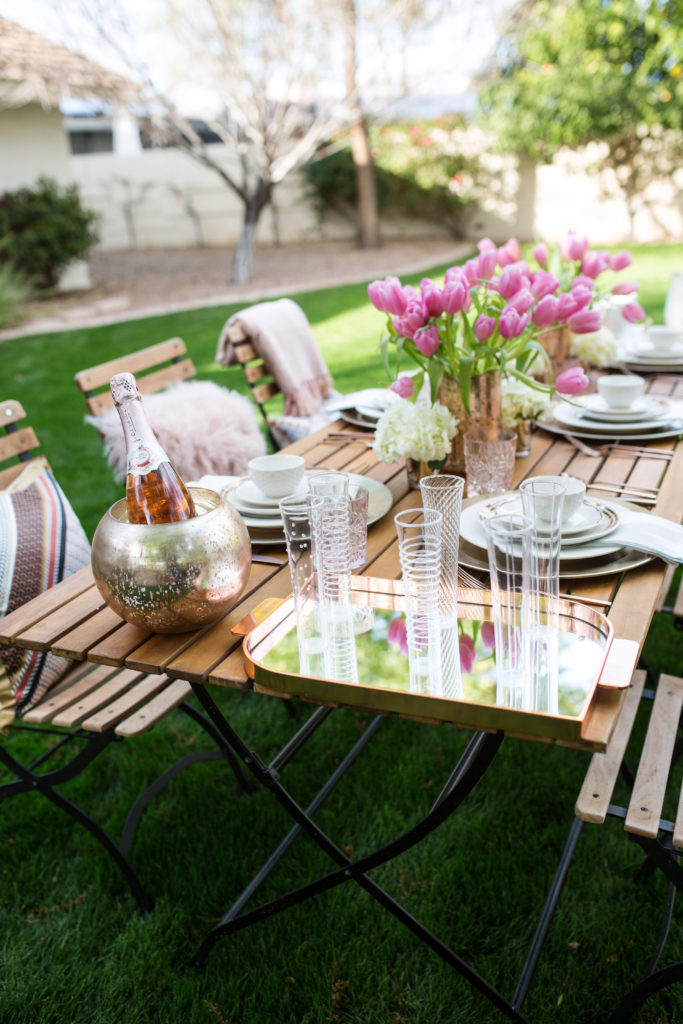 stylish rose gold Easter brunch table setting