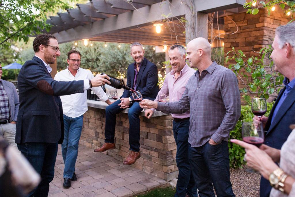 men discussing wine