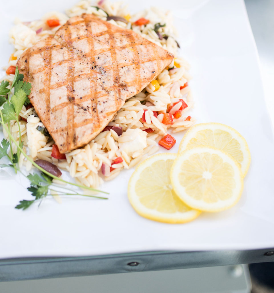 grilled salmon on orzo with feta, olives and peppers