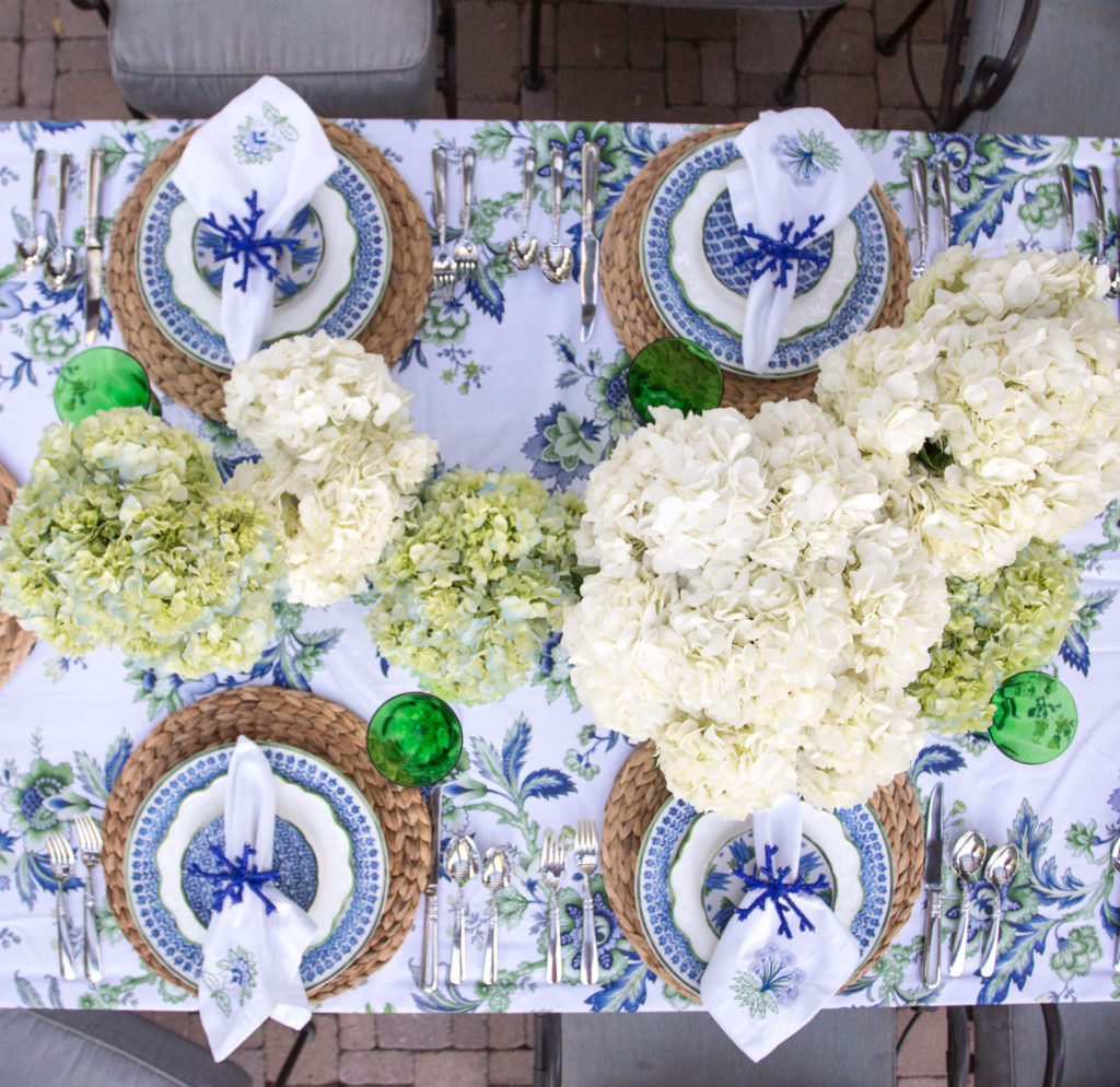 Poolside table setting with Aerin Lauder's summer collection