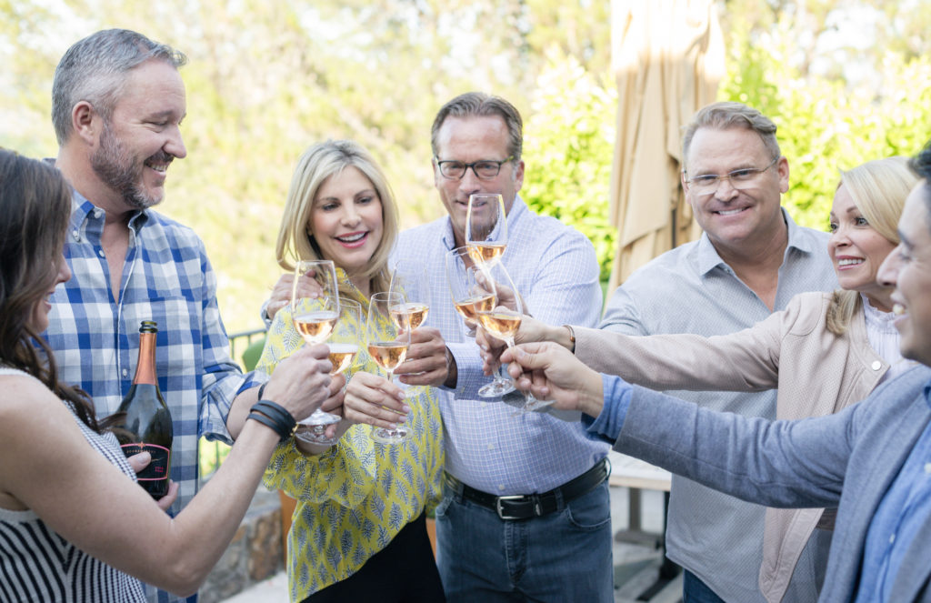 friends toasting at wine country chef dinner
