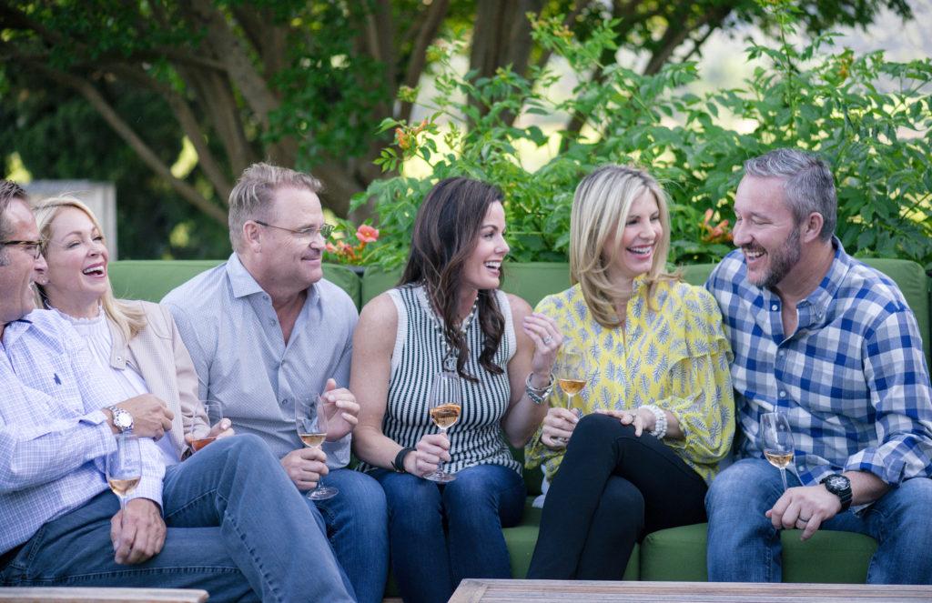 friends enjoying wine at wine country chef dinner