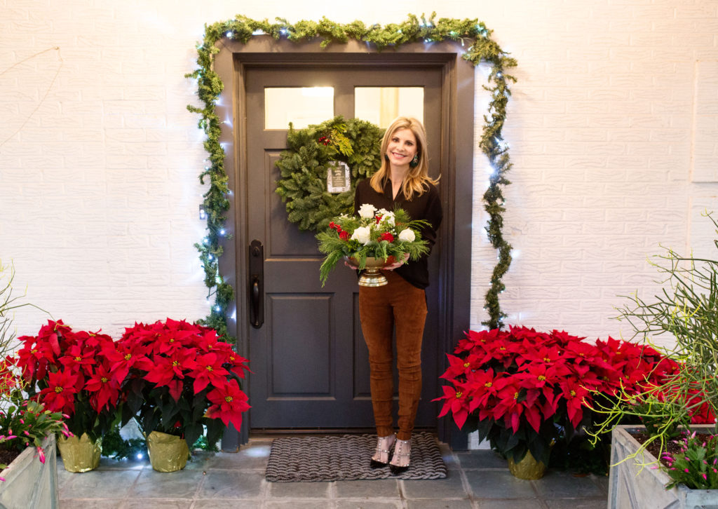 Charcoal front door with holiday greenery