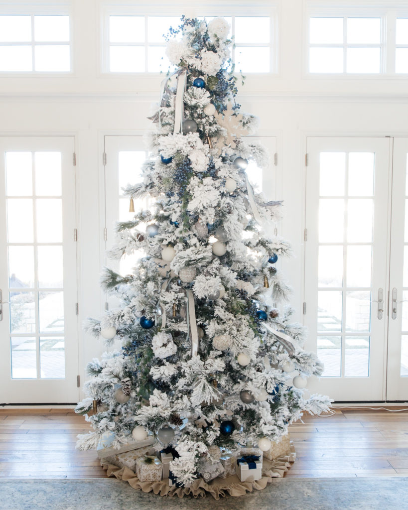 Flocked white and blue Christmas tree