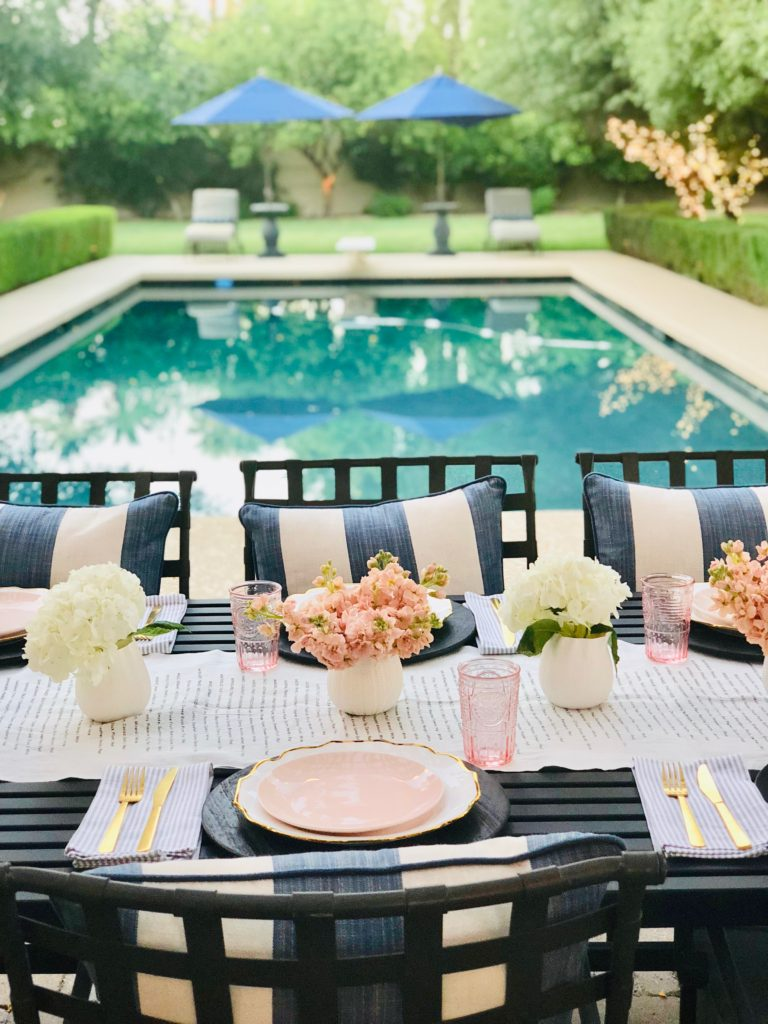 white and pink poolside table