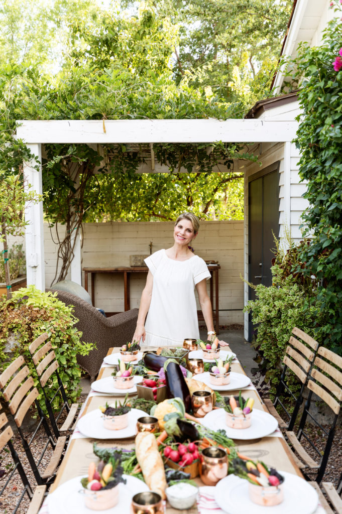 outdoor farmer's market dinner party with host